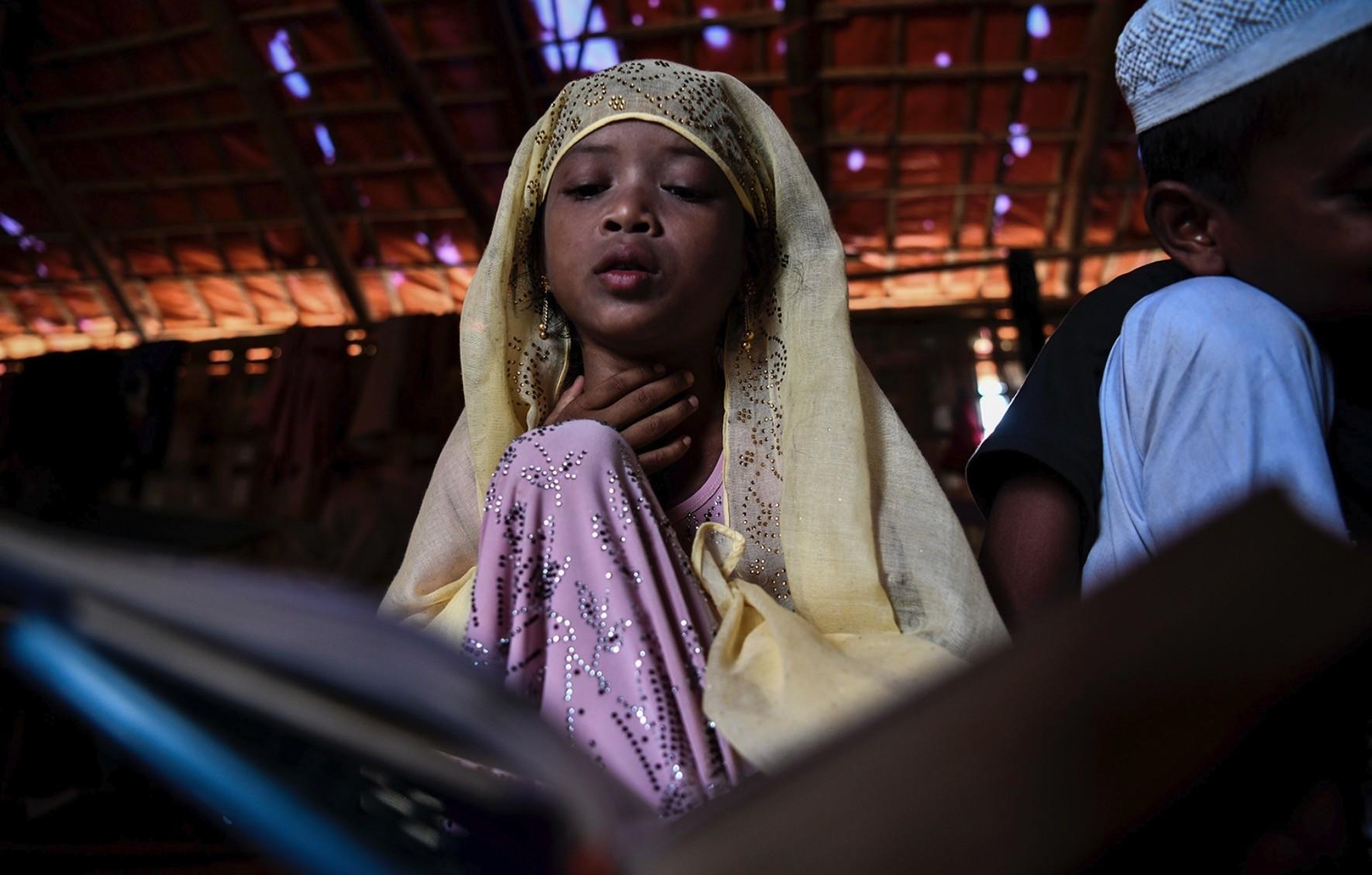 Saleema Khanam, 8, studies inside a makeshift madrassa in Kutupalong camp.