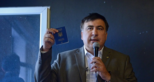 Saakashvili shows his Ukrainian passport during a meeting with Ukrainian citizens living in Poland at the Free Word Association in Warsaw, Poland, 06 August 2017. (EPA Photo)