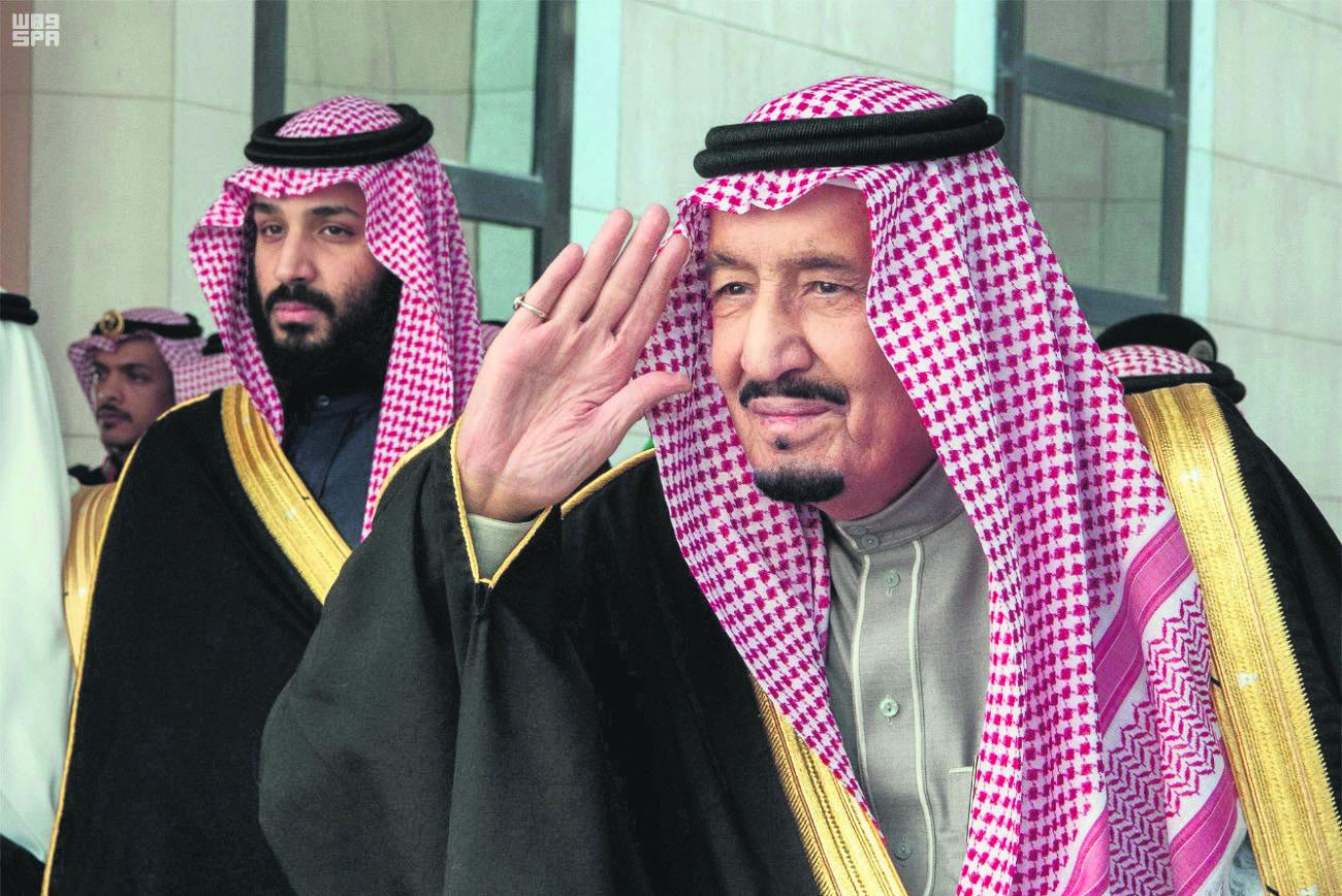 Saudi Arabia's King Salman arrives to deliver an address to Saudi consultative Shura council as Saudi Crown Prince Mohammed bin Salman stands next to him, Riyadh, Saudi Arabia, Dec. 13.