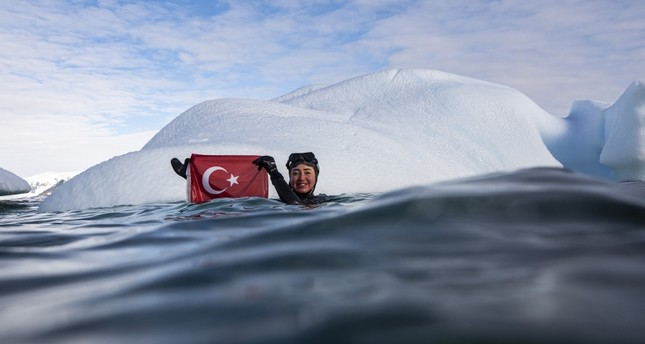 Record holder diver Ercümen takes second dip in Turkish polar base in Antarctica
