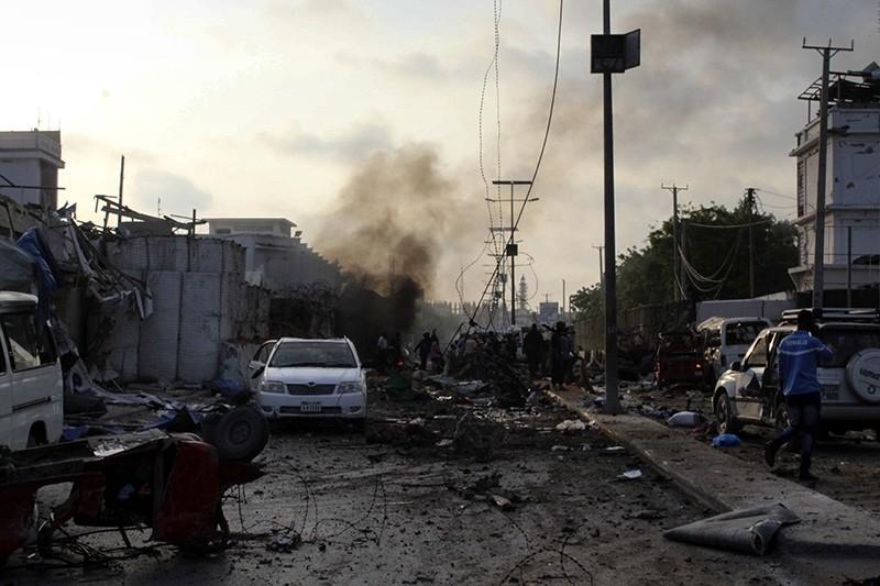 People gather at the scene of explosions outside a hotel in Mogadishu, Somalia, Nov. 9, 2018. (EPA Photo)