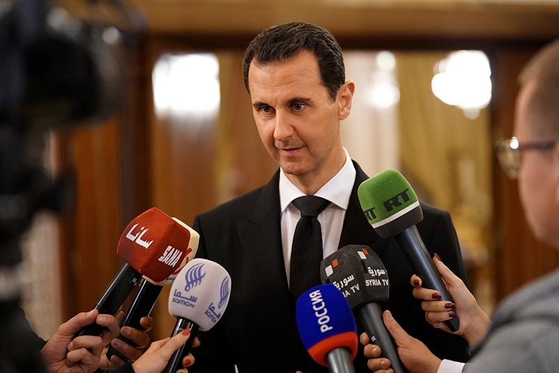 Assad speaking to reporters after a meeting with Russian Deputy Prime Minister, Dmitry Rogozin and a Russian delegation in Damascus, Syria (EPA Photo)