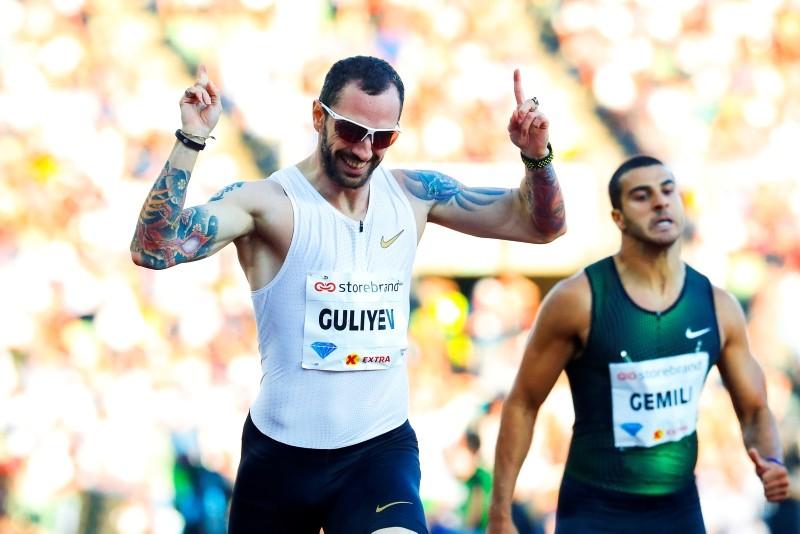 Ramil Guliyev (L) of Turkey celebrates after winning the men's 200m race at the IAAF Diamond League 2018 Bislett Games at Bislett Stadium in Oslo, Norway, June 7, 2018. (EPA Photo)