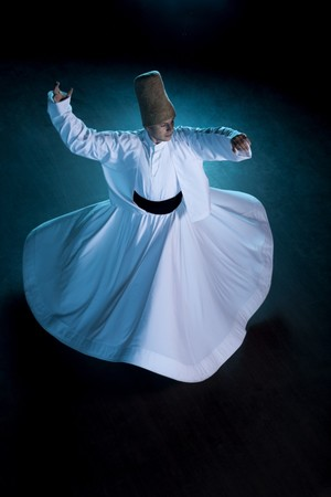 A whirling dervish spins from left to right as a symbol of his gratitude to his creator.