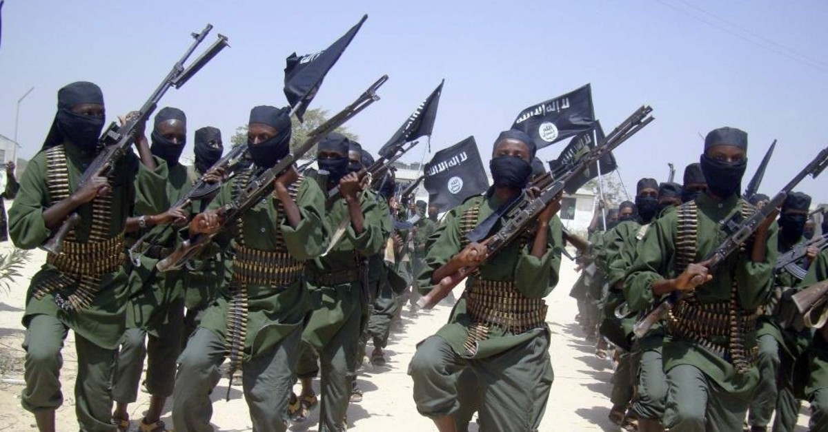 Al-Shabab militants march with their weapons during military exercises on the outskirts of Mogadishu, Feb. 17, 2011. (AP Photo)