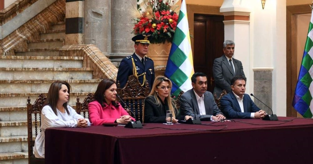 Photo released by Bolivian Presidency shows Bolivia's interim President Jeanine Anez speaking next to Bolivian Chancellor Karen Longaric (2nd L), Comunication Minister Roxana Lizarraga (L), Minister of Government Yerko Nunez (2nd R) and Defense Minister Fernando Loperz (R) during a news conference. (AFP Photo/Bolivian Presidency)