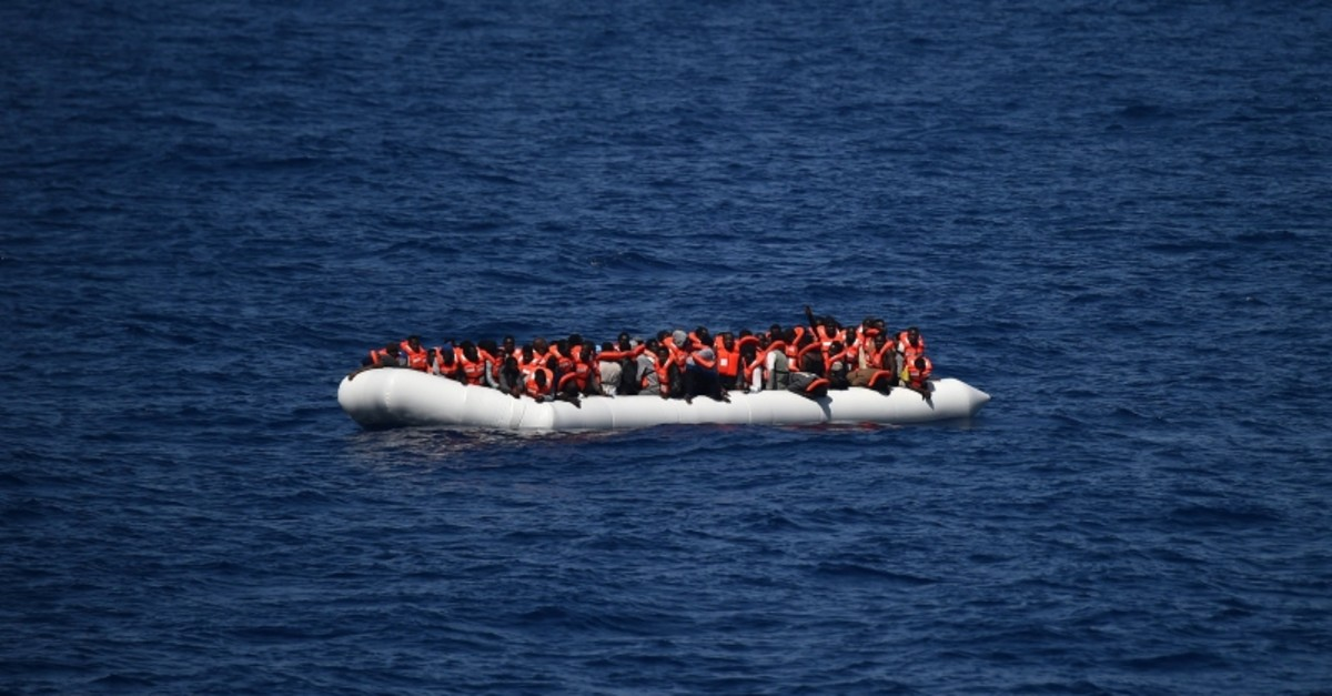 This file photo taken on May 24, 2016 shows refugees waiting on a rubber boat to be rescued during an operation at sea with the Aquarius in the Mediterranean sea in front of the Libyan coast. (AFP Photo)