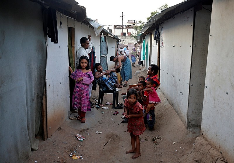 People belonging to Rohingya Muslim community sit outside their makeshift houses on the outskirts of Jammu, India, May 5, 2017. (Reuters Photo)