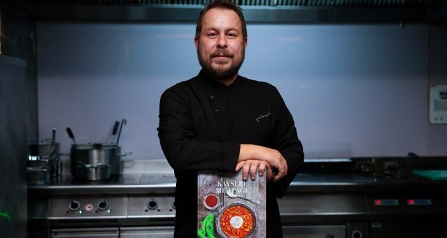 Chef Yunus Emre Akkor poses with the book that earned him a Gourmand Cook Book Award.  AA Photo