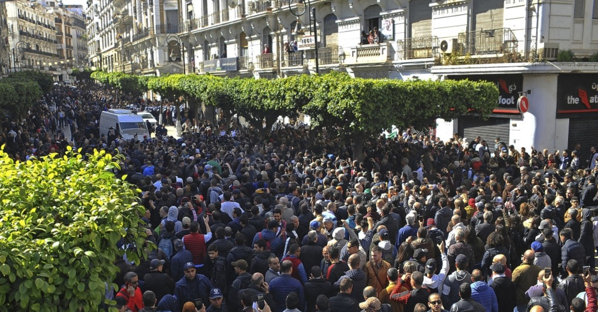 Demonstrators gather during a protest to denounce President Abdelaziz Bouteflika's bid for a fifth term, Algiers, Feb. 24, 2019.