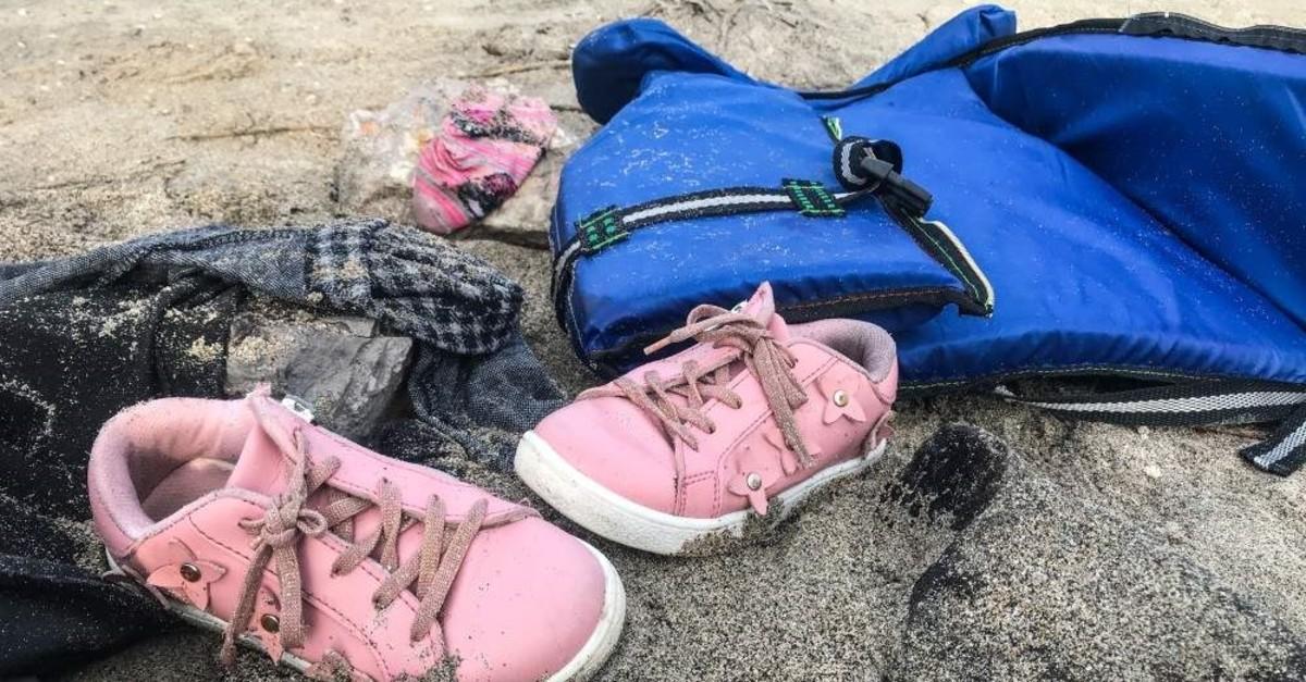 Belongings of the migrants washed ashore in u00c7eu015fme after their boats sank off u0130zmir, Jan. 12, 2020. (AA Photo)