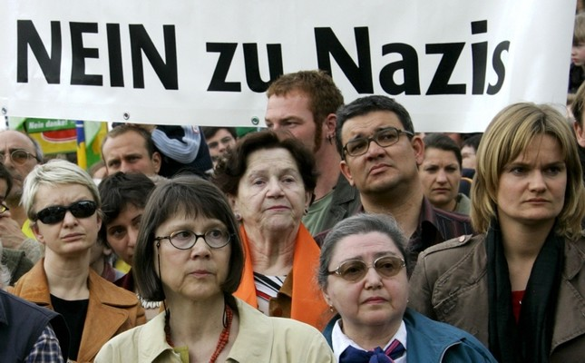 "Protesters in Postdam, Germany carry a banner that reads ""No to Nazis""."