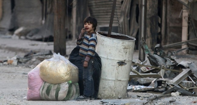 A boy standing amid the damage in the moderate-held al-Shaar neighborhood of Aleppo, Syria, Nov. 23, 2016.