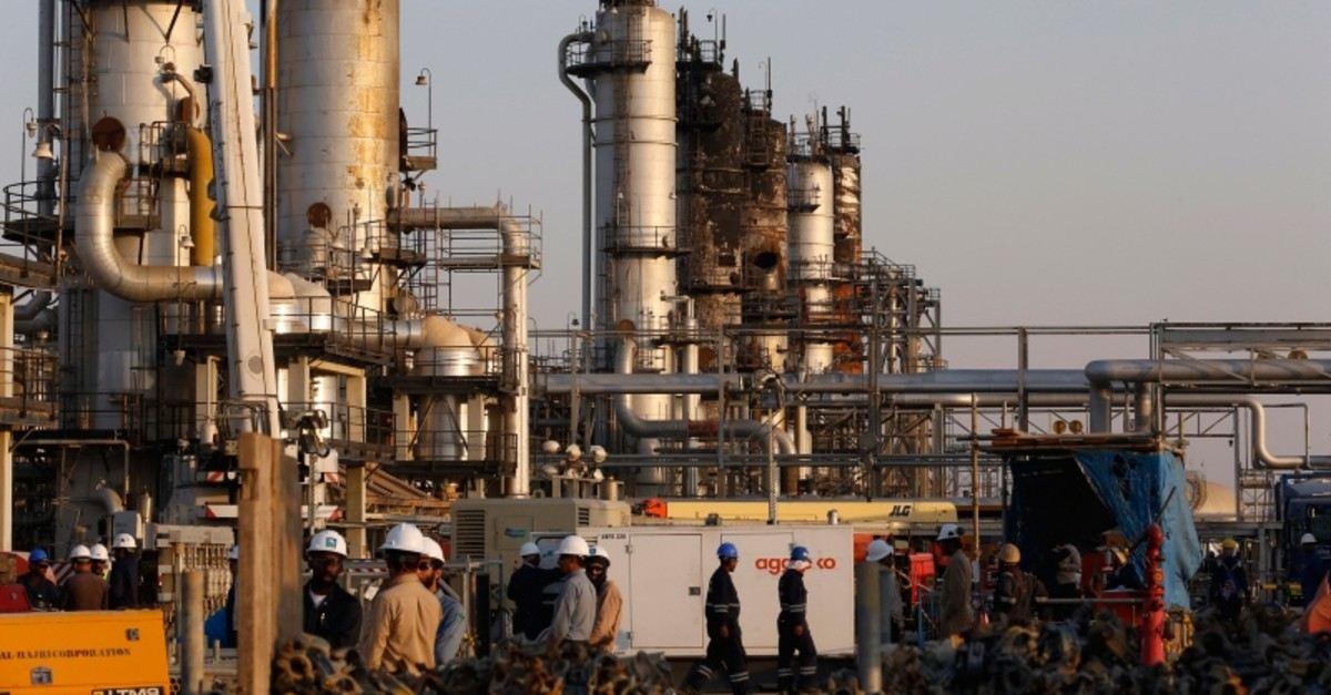 During a trip organized by Saudi information ministry, workers fix the damage in Aramco's oil processing facility after the recent Sept. 14 attack in Abqaiq, near Dammam in the Kingdom's Eastern Province, Friday, Sept. 20, 2019. (AP Photo)