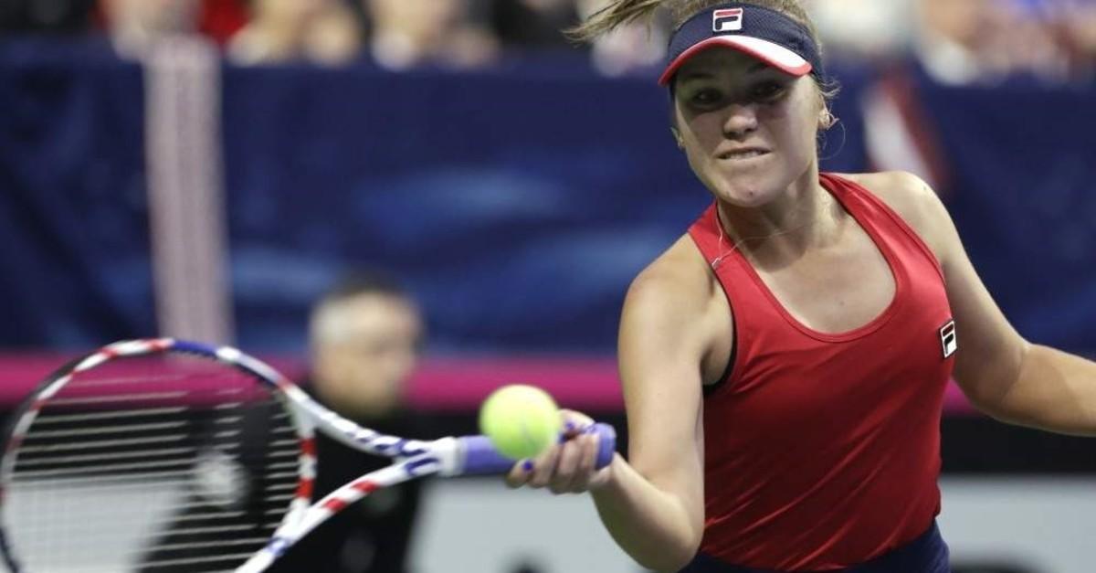 United States' Sofia Kenin returns a shot against Latvia's Jelena Ostapenko during the Fed Cup qualifying tennis match, Feb. 8, 2020. (AP Photo)
