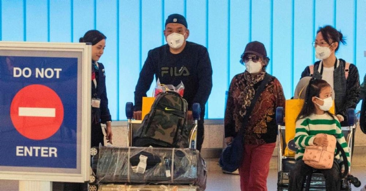 Passengers wear face masks to protect against the spread of the Coronavirus as they arrive on a flight from Asia at Los Angeles International Airport, California, Jan. 29, 2020. (AFP Photo)