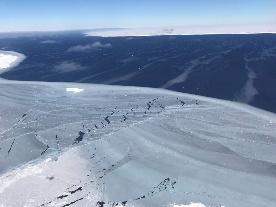 In this image released by NASA on their NASA ICE witter page, sea ice (L) is seen with the edge of iceberg A68 in the distance over the Antarctic, Nov. 1, 2017. (via AFP)