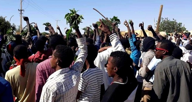 In this Sunday, Dec. 23, 2018 file handout image, provided by a Sudanese activist, people chant against the government during a protest in Kordofan, Sudan. (AP Photo)