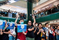 Hundreds of Hong Kong protesters take over mall, fold origami cranes