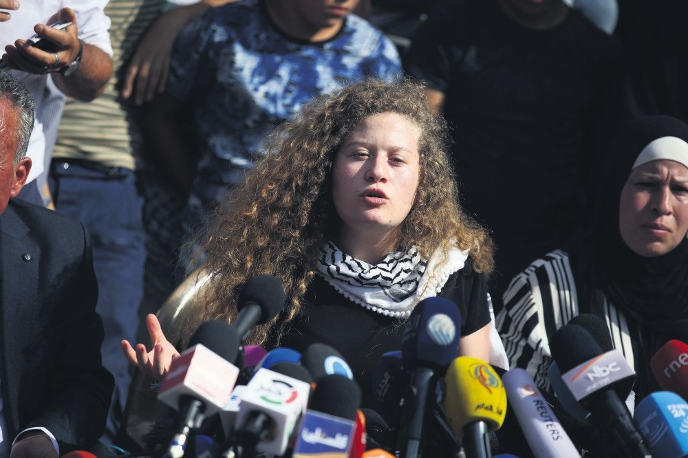 Ahed Tamimi speaks at a news conference after being released from an Israeli prison. The 17-year-old Palestinian girl was arrested for slapping an Israeli soldier during an attack on her family and home by soldiers, July 29.