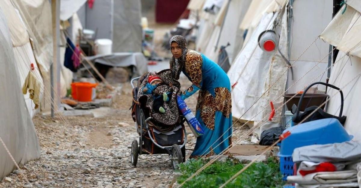 A Syrian refugee mother puts her baby into a stroller in Nizip refugee camp, Gaziantep, Nov. 30, 2016.