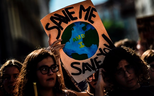 Demonstrators take part in a global youth climate action strike in Lisbon, Sept. 27, 2019.