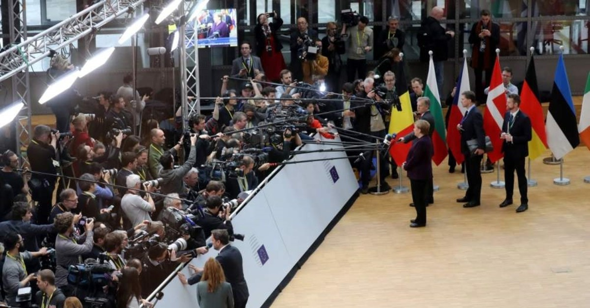 Germany's Chancellor Angela Merkel (R) and Luxembourg's Prime Minister Xavier Bettel (L) answer journalists' questions as they arrive for a special European Council summit, Brussels, Feb. 20, 2020, held to discuss the next long-term budget of the EU. (AFP Photo)