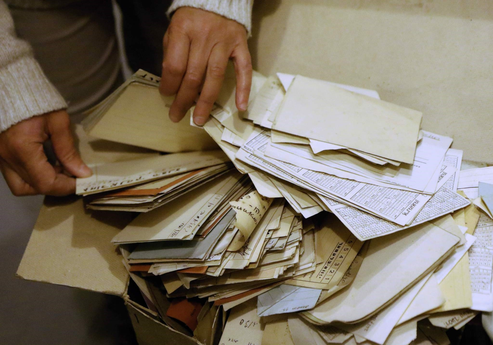 Judaica Research Centre chief Lara Lempertiene files through rediscovered Jewish documents, long thought to have been destroyed during World War II, in Lithuanian national library in Vilnius on November 3, 2017. (AFP Photo)
