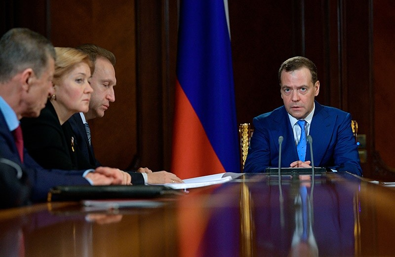Russian Prime Minister Dmitry Medvedev, right, leads a cabinet meeting in the Gorky residence outside Moscow, Russia, April 9, 2018. (AP Photo)