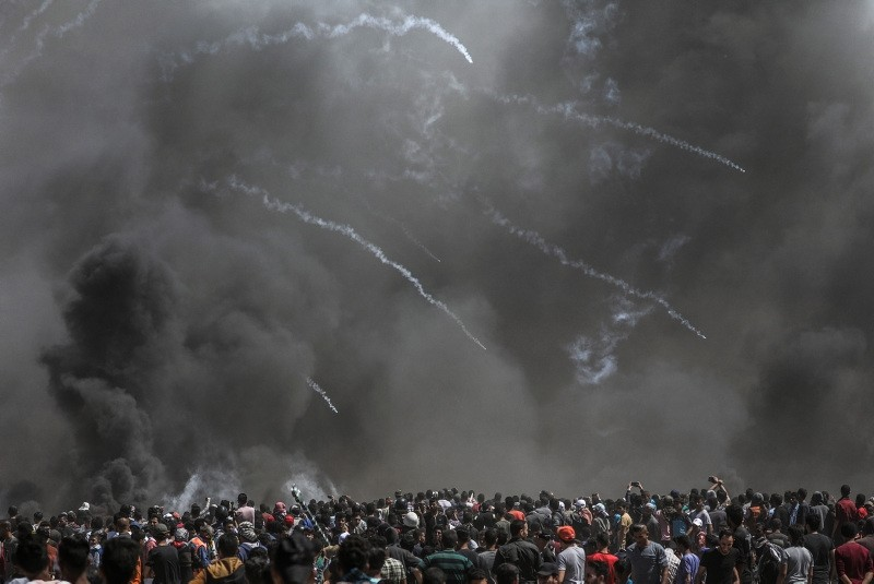 Israeli army fire tear gas grenades at Palestinian protesters during clashes after protests near the border with Israel in the east of Gaza Strip, 14 May 2018. (EPA Photo)