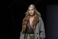 Milan Fashion Week took a formal turn for next fall and winter. Mindful of the price point, designers were not churning out looks that could be tossed into a suitcase for a fanciful journey, but...