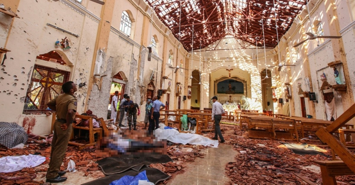 In this April 21, 2019 file photo, dead bodies of victims lie inside St. Sebastian's Church damaged in blast in Negombo, north of Colombo, Sri Lanka. (AP Photo)