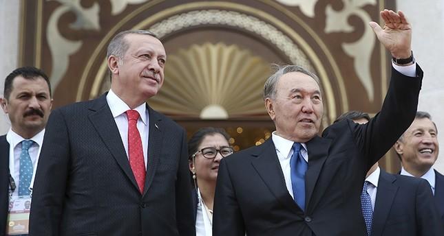 President Recep Tayyip Erdoğan (L looks on as Kazakstan's President Nursultan Nazarbayev, right, waves to supporters following their meeting in Astana, Kazakhstan, Sept. 9, 2017. (AP Photo)