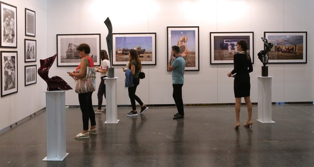 People visit an exhibition at the Contemporary Istanbul art fair, Şişli, Istanbul.