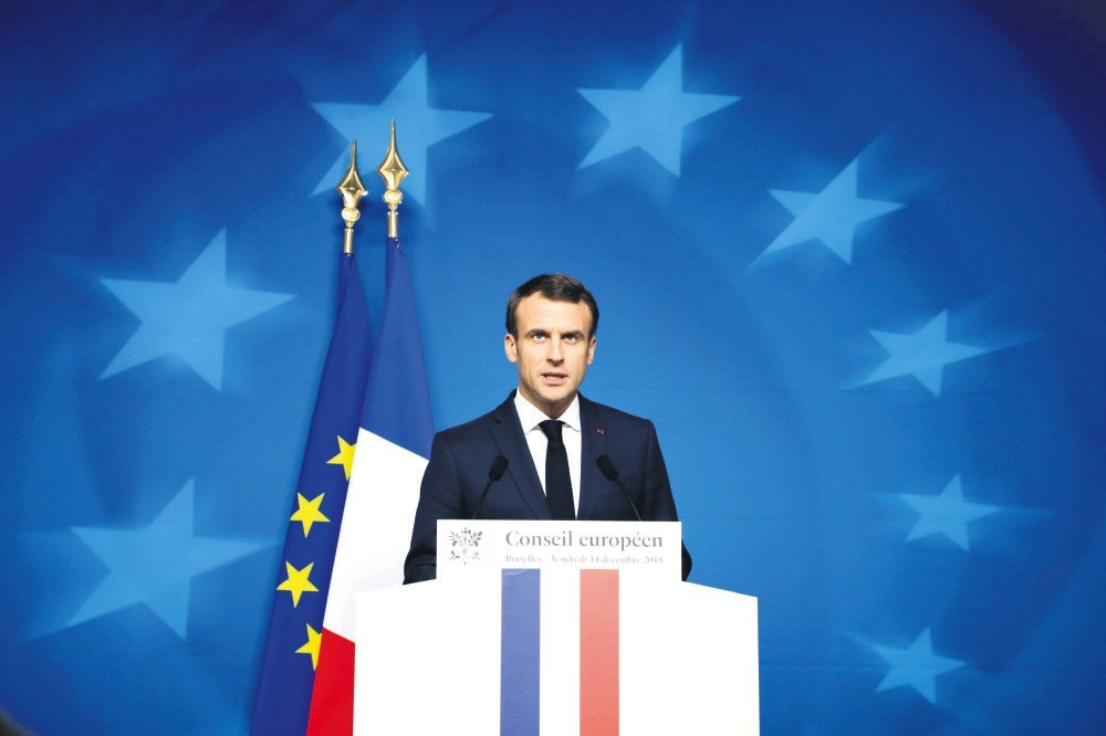 French President Emmanuel Macron speaks at a press conference during an EU summit in Brussels, Dec. 14.