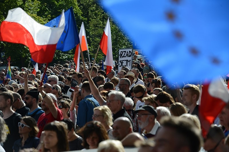 People participate in a protest against changes in the judicial law and the Supreme Court in front of the Sejm building in Warsaw, Poland, July, 16, 2017. (EPA Photo)