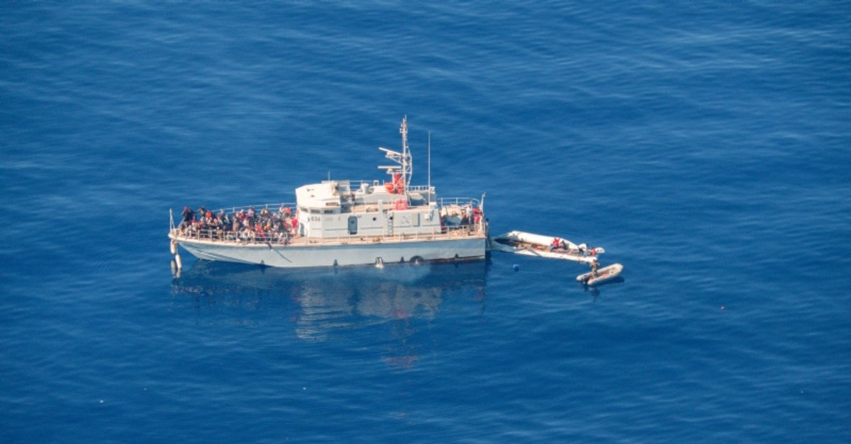 Aerial view shows Libya's coast guard ship with migrants on deck, in Search and Rescue (SAR) zone off Libya's coast May 11, 2019 (Reuters Photo)