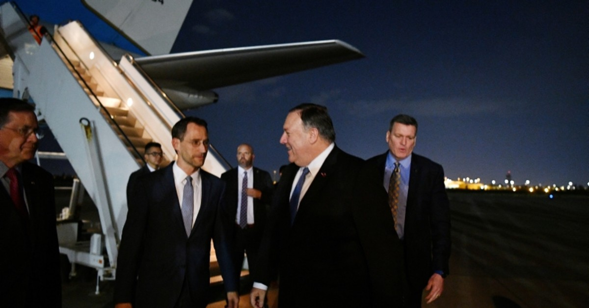 U.S. Secretary of State Mike Pompeo chats with Charge D'affaires at the US Embassy in Baghdad Joey Hood upon arrival in Baghdad, Iraq May 7, 2019. (Reuters Photo)