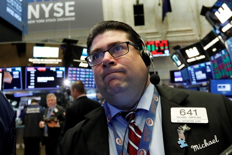 Trader Michael Capolino works on the floor of the New York Stock Exchange, Monday, Oct. 15, 2018. Stocks are opening mostly lower as technology companies continue to fall. (AP Photo)