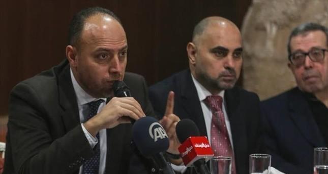 حسام زملط - رئيس المفوضية العامة لمنظمة التحرير الفلسطينية في واشنطن (يسار)