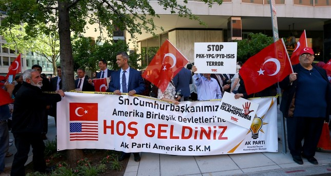 Turkish people holding banners to welcome President Erdoğan and the Turkish delegation, who arrived in Washington to meet with the Trump  administration to discuss the damaged Turkish-U.S. relations.