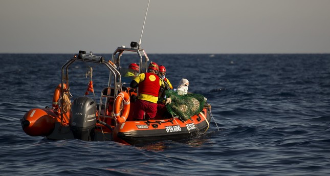 Aid workers recover a dead body floating on the Mediterranean sea, at 20 miles north of Zuwarah, Libya, on Wednesday, June 21, 2017. (AP Photo)
