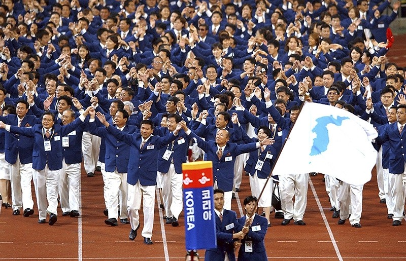 In this Sept. 29, 2002 file photo, athletes from North and South Korea march together, led by a unification flag, during an opening ceremony for the 14th Asian Games in Busan, South Korea. (AP Photo)