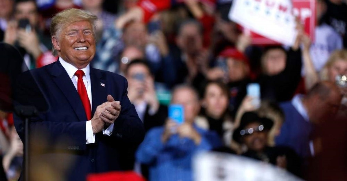U.S. President Donald Trump speaks during a Keep America Great Rally at Kellogg Arena, Michigan, Dec. 18, 2019. (AFP Photo)