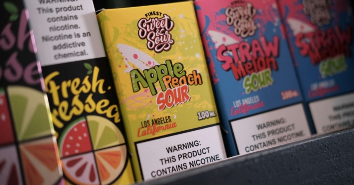 Vaping products, including flavored vape liquids and pods, are displayed at Gotham Vape in Queens, on September 17, 2019 in New York City. (AFP Photo)