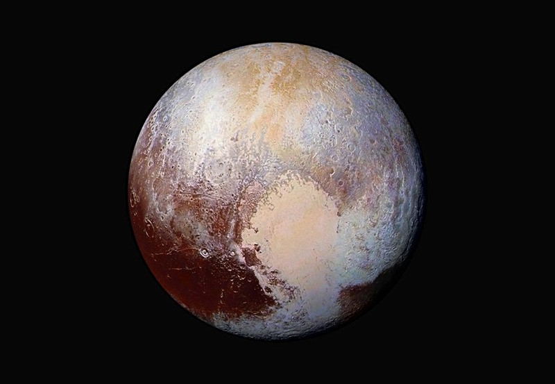 The planet Pluto is pictured in a handout made up of four images from New Horizons' Long Range Reconnaissance Imager (LORRI) taken in July 2015 combined with color data from the Ralph instrument. (Image from NASA via Reuters)