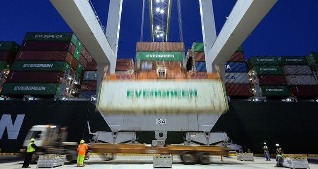 In this June, 19, 2018, file photo, an Evergreen Line refrigerated container is lifted by a ship to shore crane onto the container ship Ever Linking at the Port of Savannah in Savannah, Ga. (AP Photo)
