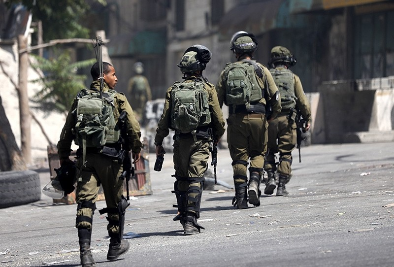 Israeli soldiers take positions during clashes with Palestinians in the occupied West Bank city of Hebron on July 27, 2018. (EPA Photo)