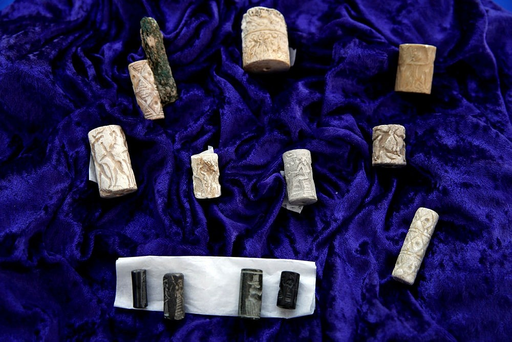 Ancient cylinder seals from Iraq are among the objects being returned by Immigration and Customs Enforcement (ICE), to Iraq, during a ceremony at the Residence of the Iraqi Ambassador to the United States, in Washington, May 2, 2018. (AP Photo)