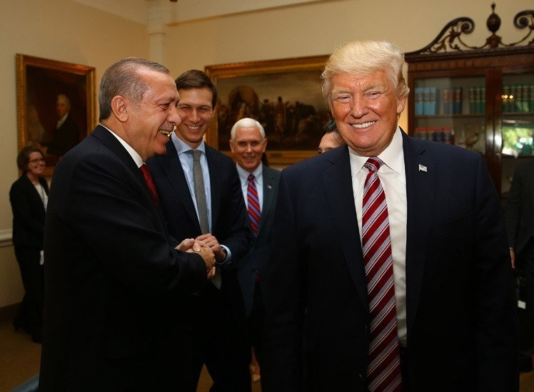 Erdou011fan (L) and Trump shake hands during the meeting at the White House, May 16, 2017.